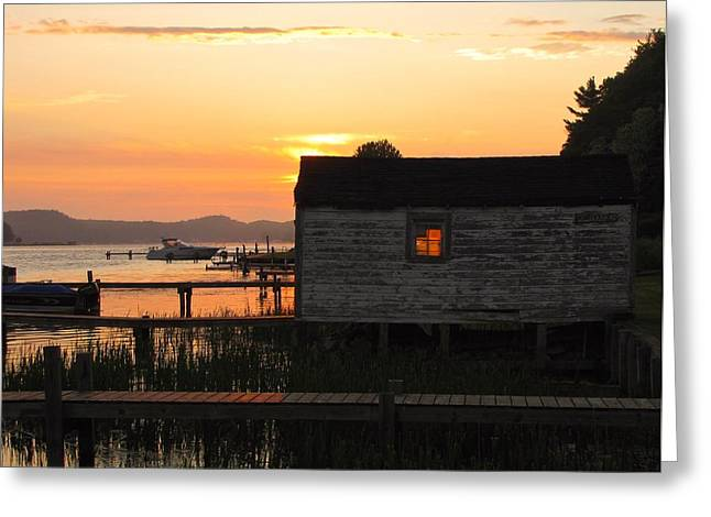 Sunset Over The Village Greeting Cards - Blazing Boathouse on Penwater Lake Greeting Card by Jane Greiner