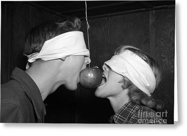 Blindfolded Teenagers Try For Apple Greeting Card by H. Armstrong Roberts/ClassicStock