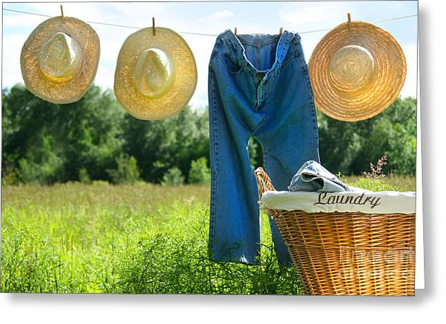 Cloth Greeting Cards - Blue jeans and straw hats on clothesline Greeting Card by Sandra Cunningham