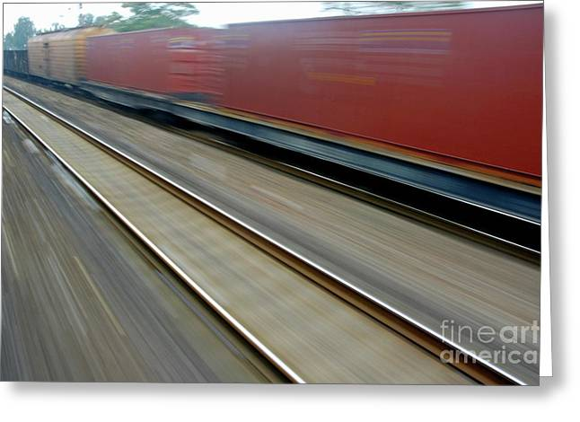Freight Transportation Greeting Cards - Blurry carriages of a freight train travelling at high speed Greeting Card by Sami Sarkis