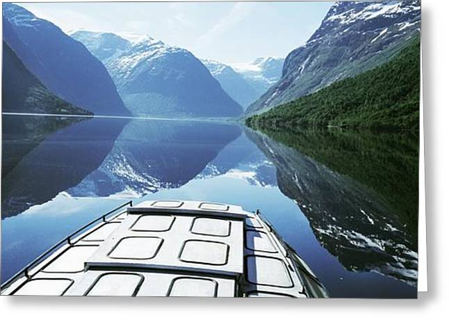 Norwegian Landscape Greeting Cards - Boat Traveling Through Lavtn Lake Greeting Card by Axiom Photographic