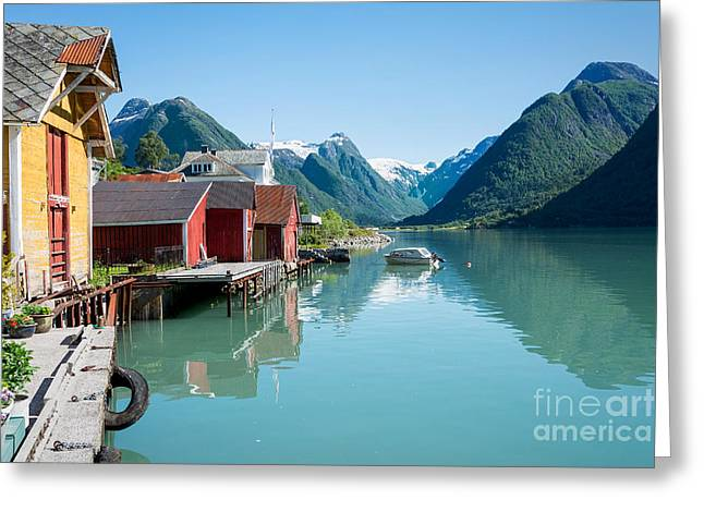 Norwegian Boathouses Greeting Cards - Boathouse with mountains and reflection in the fjord in Norway Greeting Card by IPics Photography