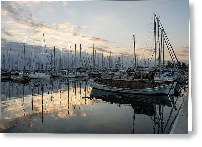 Sailboat Ocean Greeting Cards - Boats in marina at sunset Greeting Card by Radoslav Nedelchev