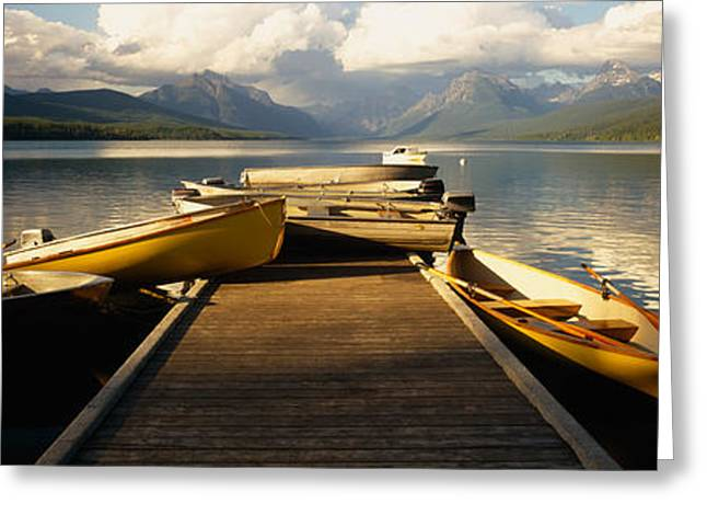 Boats Moored At A Dock, Mcdonald Lake Greeting Card by Panoramic Images