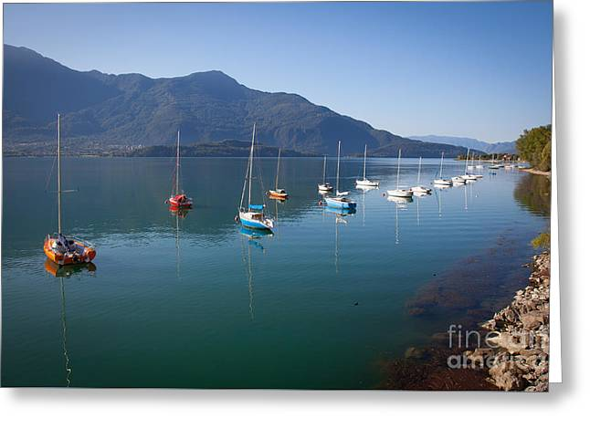 Town Square Greeting Cards - Boats on Lake Como Greeting Card by Marco Scisetti