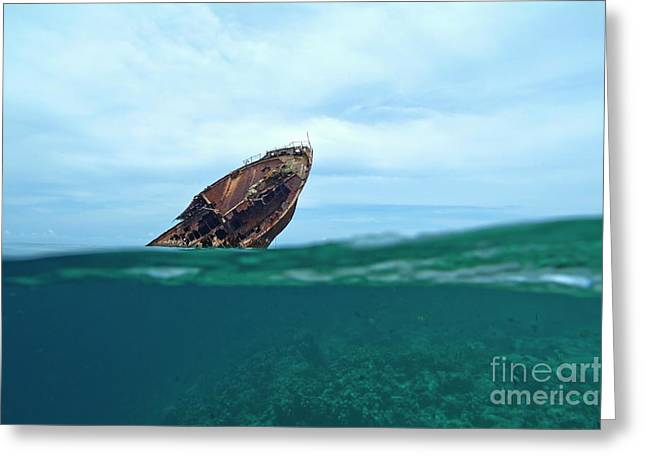 Emergence Greeting Cards - Bow of a rusty shipwreck emerges above the waters surface Greeting Card by Sami Sarkis