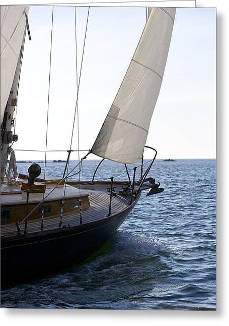 Sailboat Photos Greeting Cards - Bow Of Sailboat With Sail Open On Water Greeting Card by Gillham Studios