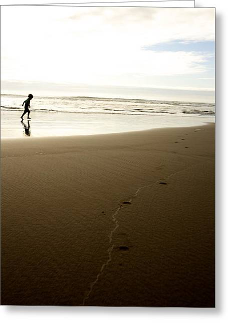 Child In Clouds Greeting Cards - Boy Running On The Beach Greeting Card by Gillham Studios