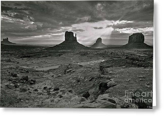 White Mittens Greeting Cards - Breaking Light at Monument Valley - Black and White Greeting Card by Brian Stamm
