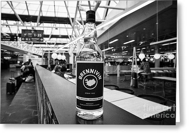 Airport Terminal Greeting Cards - brennivin icelandic spirit from duty free Keflavik airport departures area terminal building Iceland Greeting Card by Joe Fox