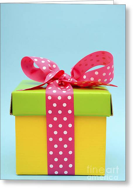 Wishes Greeting Cards - Bright color gift box on pink and blue background.  Greeting Card by Milleflore Images