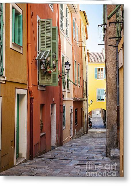 Emerald Coast Greeting Cards - Bright houses on old street in Villefranche-sur-Mer Greeting Card by Elena Elisseeva