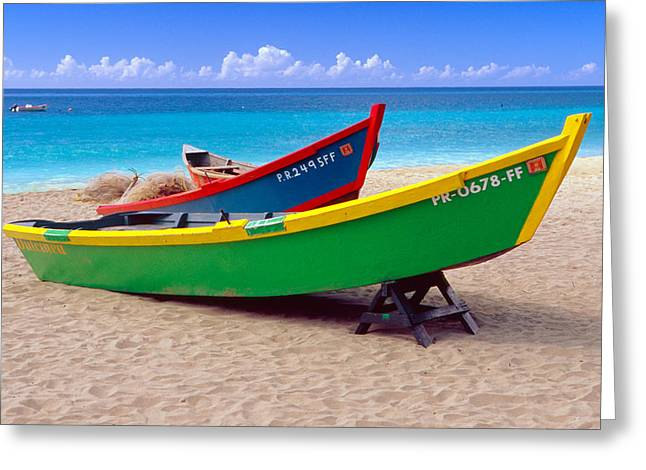 Sandy Beaches Greeting Cards - Brightly Painted Fishing Boats on a Caribbean Beach Greeting Card by George Oze