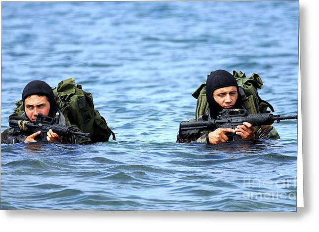 Ripples In Water Greeting Cards - Buds Students Wade Ashore During An Greeting Card by Stocktrek Images