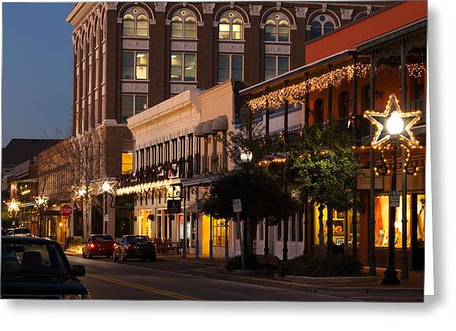 Buildings Lit Up At Dusk, Palafox Greeting Card by Panoramic Images