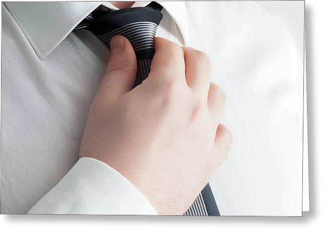 Businessman Adjusting His Tie, Close-up Greeting Card by Michal Bednarek