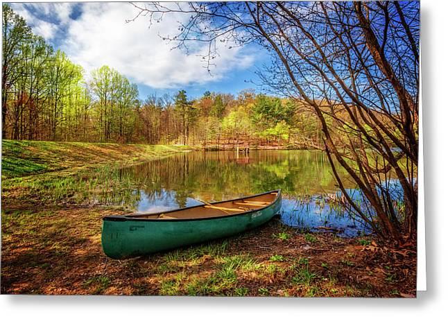 Canoe At Lakeside Greeting Card by Debra and Dave Vanderlaan