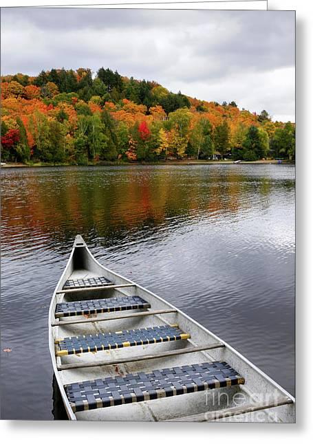 Canoe Greeting Cards - Canoe on a Lake Greeting Card by Oleksiy Maksymenko