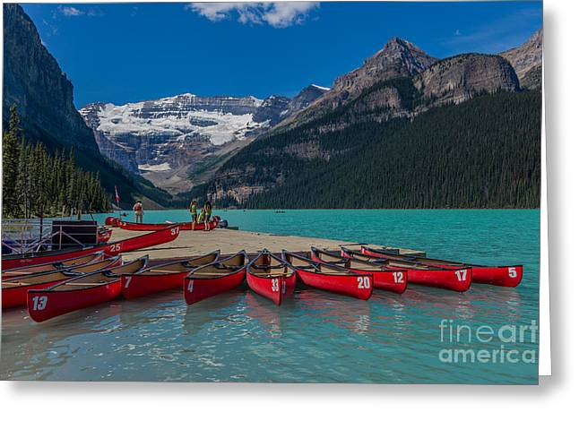 Snow Capped Greeting Cards - Canoes on Lake Louise Greeting Card by John Roberts