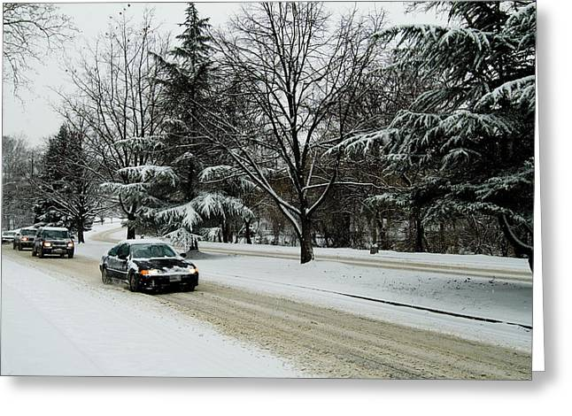 Arlington Greeting Cards - Cars Driving Over A Snow Covered Greeting Card by Todd Gipstein