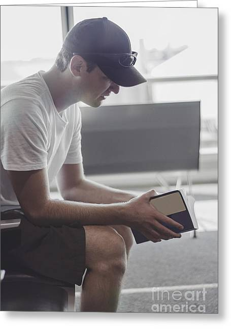 Exchanging Information Greeting Cards - Casual exchange student reading book in airport Greeting Card by Ryan Jorgensen