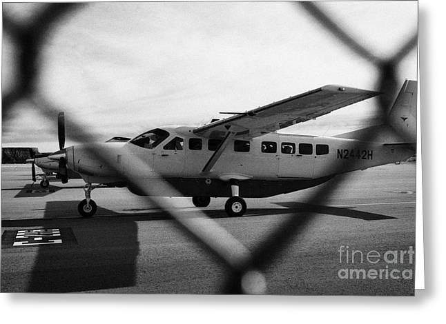 Cessna Greeting Cards - cessna 208B sightseeing tour aircraft at Grand canyon west airport Arizona USA Greeting Card by Joe Fox