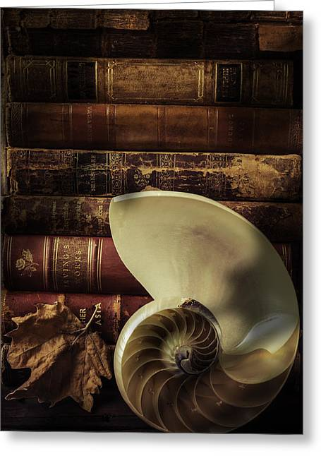 Shell Texture Greeting Cards - Chambered Nautilus Shell  With old Books Greeting Card by Garry Gay