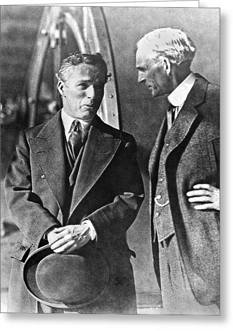 Charlie Chaplin And Henry Ford Greeting Card by Underwood Archives