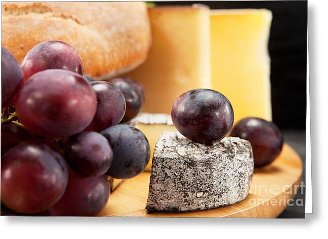 Cheese Greeting Cards - Cheese plate with red wine grapes and white bread Greeting Card by Wolfgang Steiner