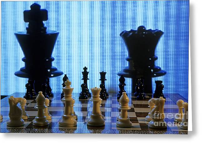 Chess board with King and Queen chess pieces in front of TV scre Greeting Card by Sami Sarkis