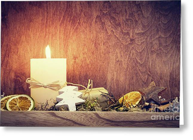 Chistmas Decoration With Candle Glowing On Wooden Wall Background Greeting Card by Michal Bednarek