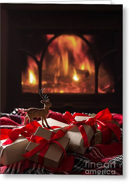 Christmas Gifts By The Fireplace Greeting Card by Amanda And Christopher Elwell