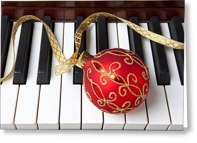 Keyboard Photographs Greeting Cards - Christmas ornament on piano keys Greeting Card by Garry Gay
