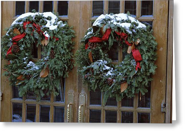 Entrance Door Greeting Cards - Christmas Wreaths Hanging On Doors Greeting Card by Panoramic Images