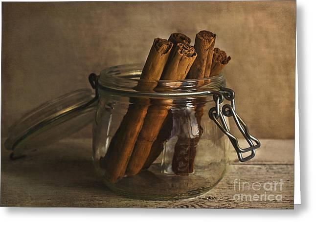 Cinnamon Greeting Cards - Cinnamon sticks in a glass jar Greeting Card by Elena Nosyreva