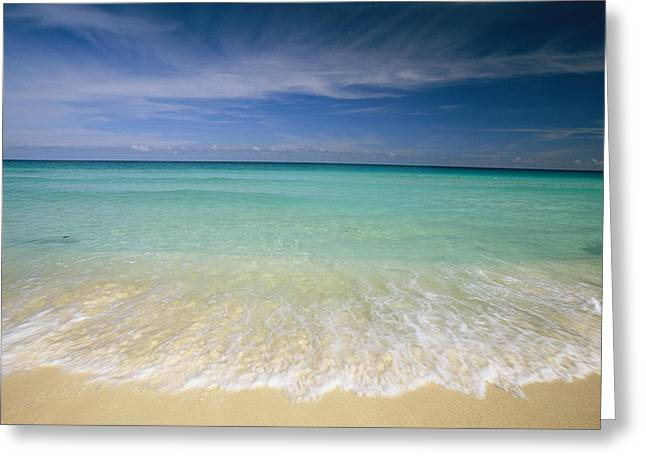 Clear Blue Water And Wispy Clouds Greeting Card by Michael Melford