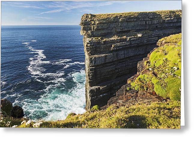 Cliffs Over Ocean Greeting Cards - Cliff Face Rock Formation In Ocean Greeting Card by Michael Interisano