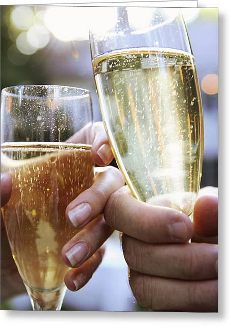 Toast Greeting Cards - Close-up Of Champagne Flutes Greeting Card by Gillham Studios