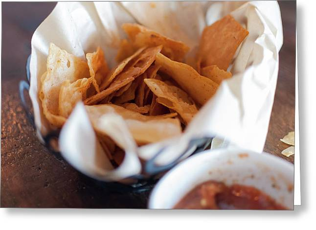 Close-up Of Corn Chips And Bowl Of Salsa Greeting Card by Bradley Hebdon