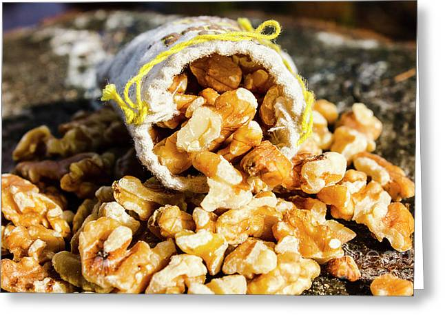 Closeup Of Walnuts Spilling From Small Bag Greeting Card by Jorgo Photography - Wall Art Gallery
