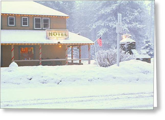 Small Towns Greeting Cards - Colorful Hotel In Winter Snowstorm Greeting Card by Panoramic Images
