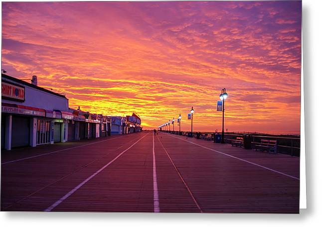 Colorful Skies On The Ocean City Boardwalk Greeting Card by Bill Cannon