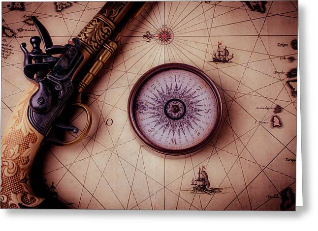 Compass And Pistole On Old Map Greeting Card by Garry Gay