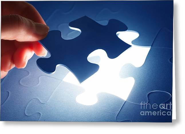 Completing The Last Piece Of Jigsaw Puzzle Greeting Card by Michal Bednarek