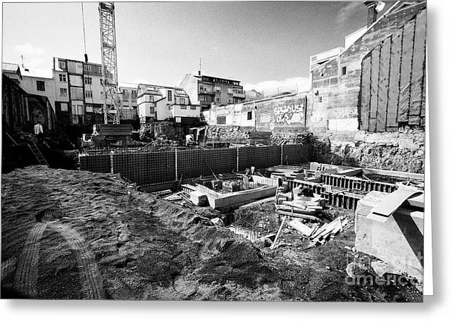 construction site with basement excavation in downtown reykjavik city centre Iceland Greeting Card by Joe Fox