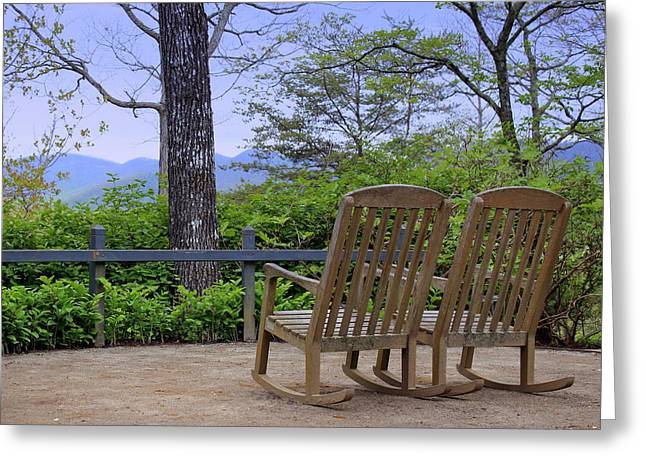 A Conversation Between Trees And Two Wooden Rocking Chairs Greeting Card by Katharine Hanna