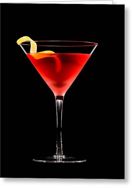 Fizzy Greeting Cards - Cosmopolitan cocktail in front of a black background  Greeting Card by Ulrich Schade