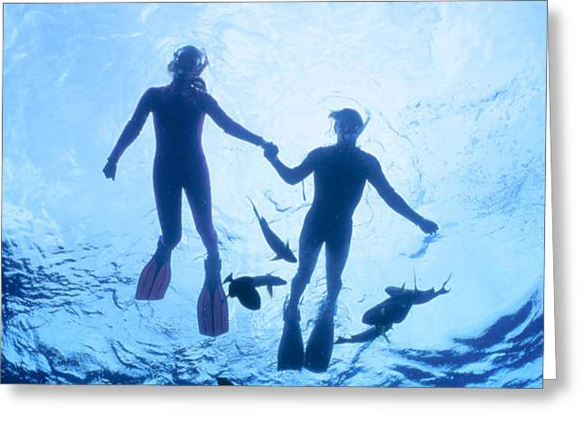 Couple At The Surface Greeting Card by Ed Robinson - Printscapes