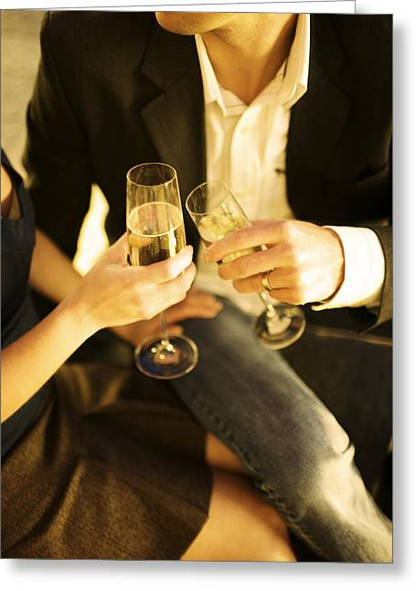 Champagne Glasses Greeting Cards - Couple Sitting, Clinking Champagne Greeting Card by Ink and Main