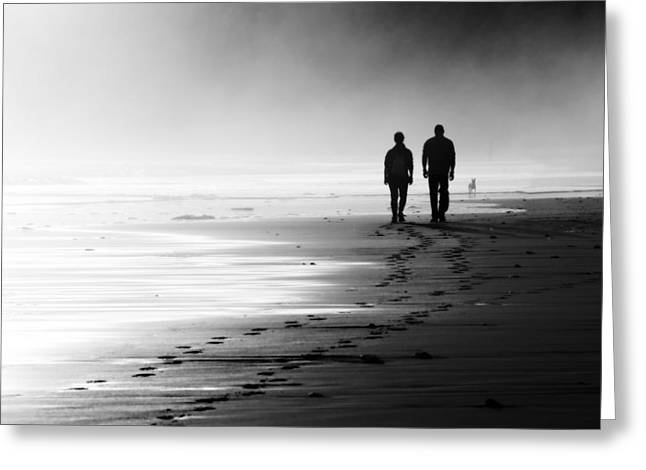 Sand Man Greeting Cards - Couple Walking On Foggy Beach Greeting Card by Mikel Martinez de Osaba